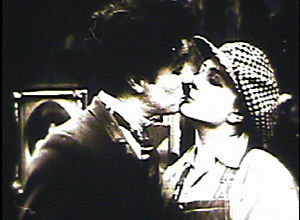 Behind the Screen - Chaplin kissing Purviance in Behind the Screen