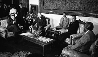 Indonesian President Suharto with U.S. President Gerald Ford in Jakarta on 6 December 1975, one day before the Indonesian invasion of East Timor. Kissinger, Ford, Suharto and Malik (cropped).jpg