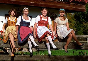 Dirndl - Women wearing dirndls and sitting in a cross-legged position.