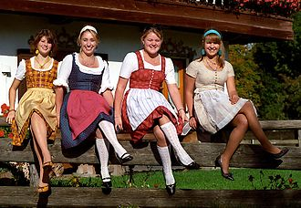 Dirndl - Seated women wearing modern dirndls