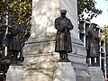 LNWR War Memorial, Euston - northwest, southwest and southeast statues.jpg