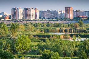 Văcărești Nature Park - Văcărești Park with Bucharest apartment buildings in the background