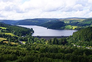 Reservoir - Lake Vyrnwy Reservoir. The dam spans the Vyrnwy Valley and was the first large stone dam built in the United Kingdom.