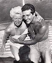 Man and woman in bathing suits, embracing
