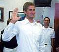 Larsen Jensen, left, a two-time Olympic medalist, takes the oath of office at the headquarters of Navy Recruiting District Los Angeles, Calif., April 15, 2009, before departing for Officer Candidate School 090415-N-FH966-006 (cropped1).jpg