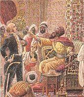 Tableau représentant un pacha turc assis sur son trône qui brandit un éventail vers un homme habillé de façon européenne, la scène se situe dans un palais de style oriental.