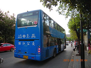 Dongba symbols - Dongba symbols are printed on buses in Lijiang.