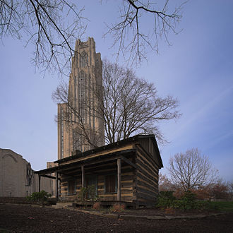 Log Cabin (University of Pittsburgh) - The log cabin is located on the lawn of the university's Cathedral of Learning (center background) and next to the school's Stephen Foster Memorial (background left)