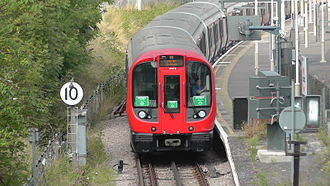District line - District line S7 S Stock train at Kensington (Olympia) station.