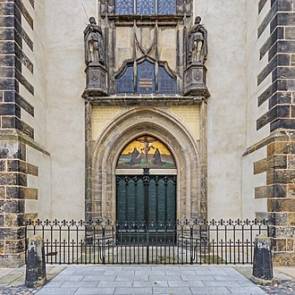 Martin Luther - Luther's theses are engraved into the door of All Saints' Church, Wittenberg. The Latin inscription above informs the reader that the original door was destroyed by a fire, and that in 1857, King Frederick William IV of Prussia ordered a replacement be made.