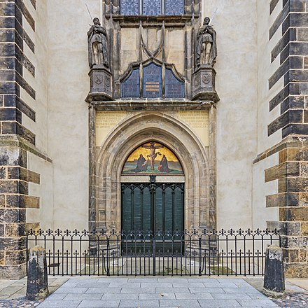 Door displaying the Ninety-five Theses at All Saints' Church, Wittenberg. In 1517 Martin Luther nailed his Theses to this door, beginning the Reformation. Lutherstadt Wittenberg 09-2016 photo06.jpg