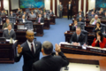 Mack Bernard ceremonially is administered the oath of office in the House chamber by House Clerk Bob Ward.png