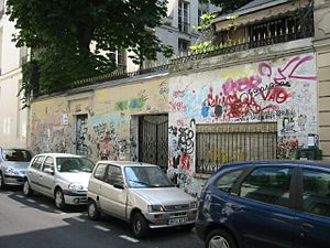 Serge Gainsbourg - Tribute graffiti covers the outer wall of Serge Gainsbourg's house on the rue de Verneuil in Paris, looked after by Charlotte Gainsbourg after her father's death