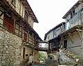 Maisons adossées au chevet de la collégiale Saint-Martin de Montpezat-de-Quercy -1.jpg