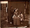 Manchu lady having her hair styled. John Thomson. China, 1869. The Wellcome Collection, London.jpg