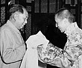 Mao Zedong receives Tibetan Buddhist prayer scarf from Tenzin Gyatso, the 14th Dalai Lama of Tibet in 1954 (cropped).jpg