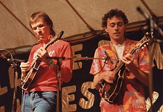 Mark O'Connor - O'Connor (left) playing mandolin on stage at the 1985 Cambridge Folk Festival