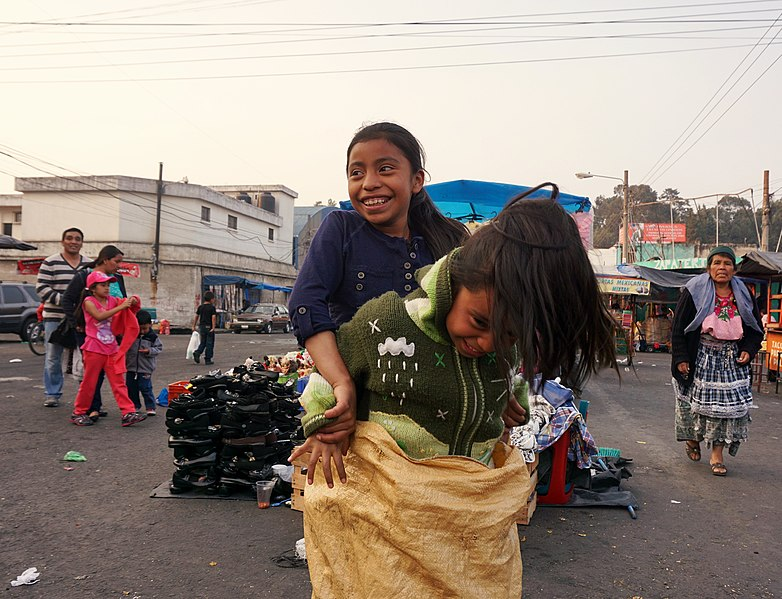 File:Mayan girls playing sack race on the market of Quetzaltenango, Guatemala.JPG