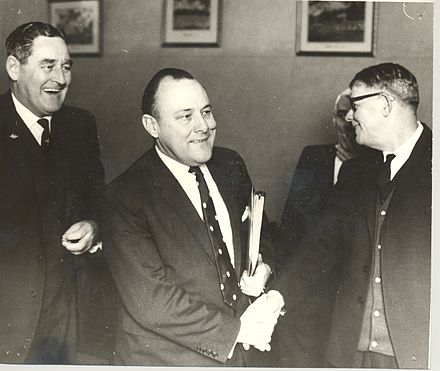 Muldoon (centre) as Minister of Finance, 26 June 1969; with him are Allan McCready MP and A J Shaw McCready Muldoon Shaw 1969.jpg