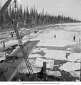 Men cutting ice away from the steamboat SEATTLE -3 on the Yukon River, 1909 (AL+CA 2937).jpg