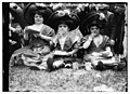 Midgets eating lunch - May party - Central Park. Three midgets sitting on the grass. LCCN2014688122.jpg