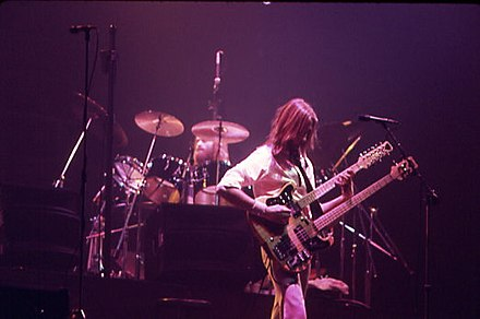 Genesis bandmate Mike Rutherford on bass with Collins on drums, performing in Toronto, 3 June 1977 MikeRutherford.jpg