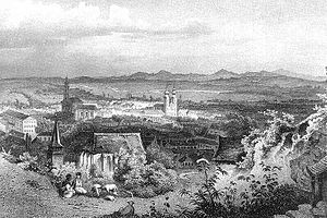 Miskolc - Historical picture of the city. View from the Avas hill with the Gothic church in the foreground. The church with two towers is the Minorite Church on today's Heroes' Square.