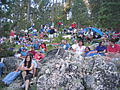 Mount Rushmore crowd sitting in rocks.JPG