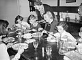 Mrs Carter enjoys Sunday lunch with her evacuated children Michael and Angela during a day trip to their foster home in Hayward's Heath in 1940. D258.jpg