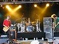 Muse at Roskilde Festival 2000 (4688870226).jpg