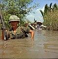 NARA 111-CCV-603A-CC44815 199th Light Infantry Brigade wading through irrigation canal Operation Rang Dong 1967.jpg