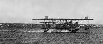 "Seaplane - Curtiss NC Flying Boat ""NC-3"" skims across the water before takeoff, 1919."