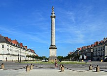 Large column with a statue of Louis XVI on top