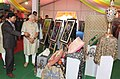 Narendra Modi visits an exhibition on the venue for foundation stone laying ceremony of Trade Facilitation Center and Crafts Museum and Inauguration of Powerloom Service Center, at Varanasi, Uttar Pradesh.jpg