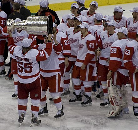 Niklas Kronwall handing over the Stanley Cup after defeating the Pittsburgh Penguins in the 2008 Stanley Cup Finals. Niklas Kronwall with Stanley Cup.jpg