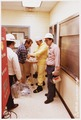 Nuclear Regulatory Commission inspector checking health physics - NARA - 540033.tif