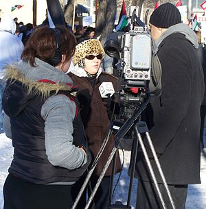 CJCO-DT - An OMNI TV news crew interviews a protester at a pro-Gaza rally in Downtown Calgary on December 31, 2008