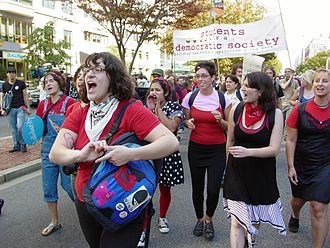 October Rebellion - Radical cheerleaders perform a cheer during the march to the World Bank.