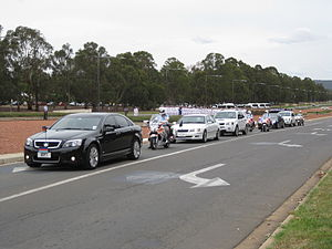 Official state car - A motorcade transporting senior members of the official party to an event in Canberra in November 2009. The black car at the left with the numberplate ADF1 carried the Chief of the Defence Force, the white car behind it with the numberplate C1 carried the Prime Minister and the black car second from the right carried the Governor General