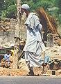 Old man walking in India.jpg