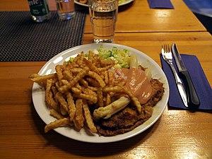 Schnitzel - Oskarinleike with fries.