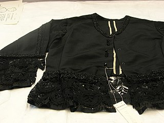 Bombazine Twill fabric usually made of silk warp and worsted weft, often dyed black and used for mourning wear