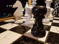 Oversized chess pieces on a tile board.jpg