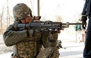 LSAT light machine gun - LSAT without magazine, mock fire for the first time by Picatinny Senior Commander and PEO Ammunition Brig. Gen. Jonathan A. Maddux at Picatinny Arsenal
