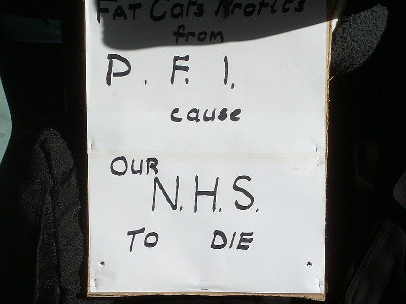 File:PFI Protest placard.JPG