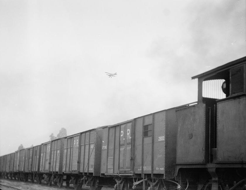 Palestine disturbances 1936. Palestine railroad train, showing aeroplane escort flying above