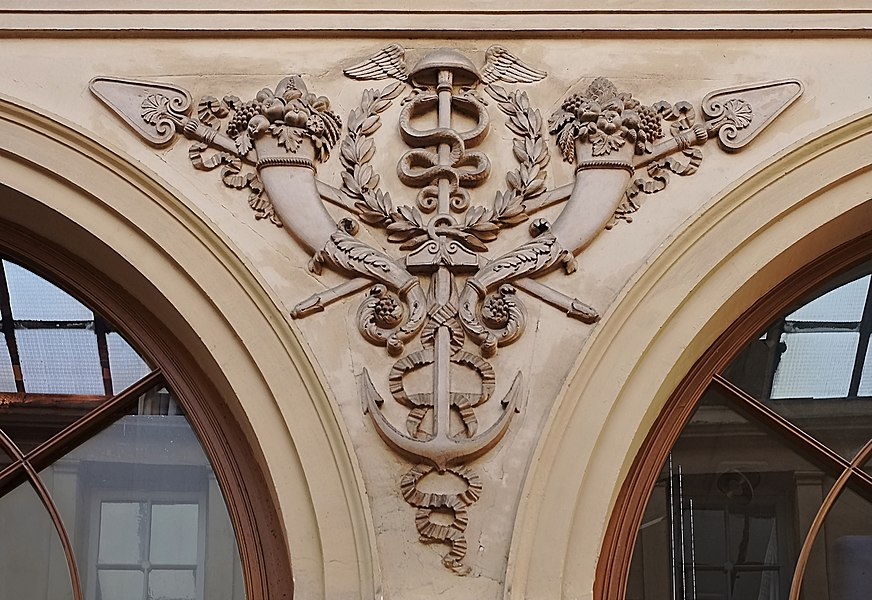 Symbolic patterns carved on the inner walls of Galerie Vivienne, Paris (2nd arr.), France.