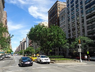 Park Avenue in the Upper East Side, lined with apartment buildings, looking north from East 74th Street (September 2016)