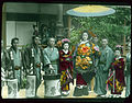 People in special attire, with lanterns, posing for photograph. (19923866606).jpg