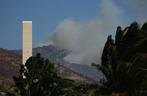 Pepperdine University - Smoke billows on a hill near Pepperdine University's Theme Tower.
